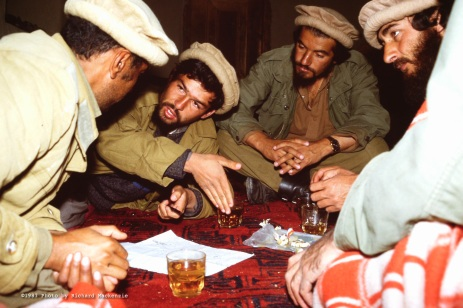 Over endless cups of tea sweetened with candy, Dr. Husain (at right) listens as Massoud's key intelligence officers gather details for an imminent battle.
