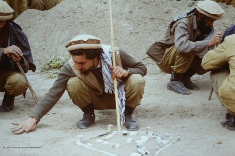 Ahmad Shah Massoud inspects the sand table model, paying attention to every detail to ensure accuracy.