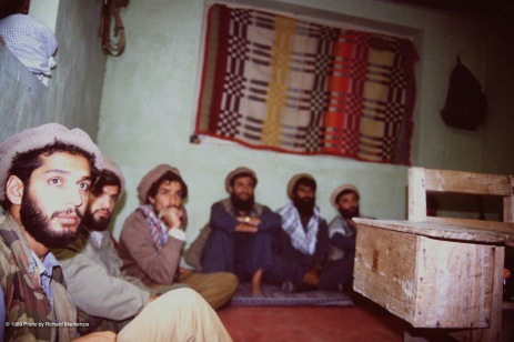 Haron (left) sitting with Massoud and mujahideen for briefing.