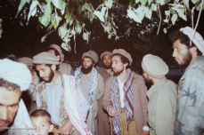 Haron walking with Massoud and mujahideen near Taloqan.