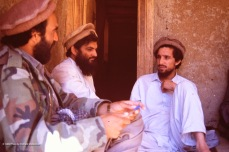 Massoud talks with key personnel in a desolate village.