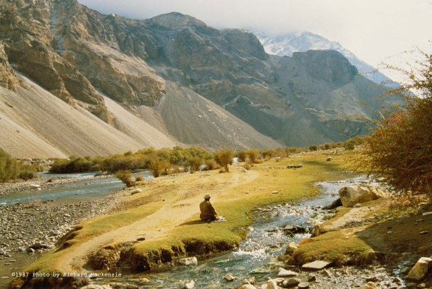A lone mujahid stops for prayer in 1987 during a day's march down the Kochka River in Northern Afghanistan.