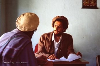 Ahmad Shah Massoud meets with a civic leader in the town of Taloqan shortly after it was captured in 1989.