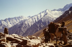 Timeless terrain… And a loving son of Afghanistan, Rahman Baig, crossing the Hindu Kush as winter approaches in 1987.