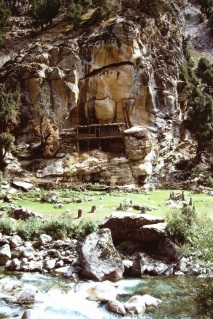 A lone house perched on the side of a mountain in Nuristan.
