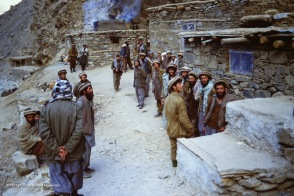 Mujahideen gather as they wait in the shadow of a karaghah in the Panjshir Valley.