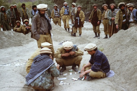 Mujahideen building model garrison out of cardboard.
